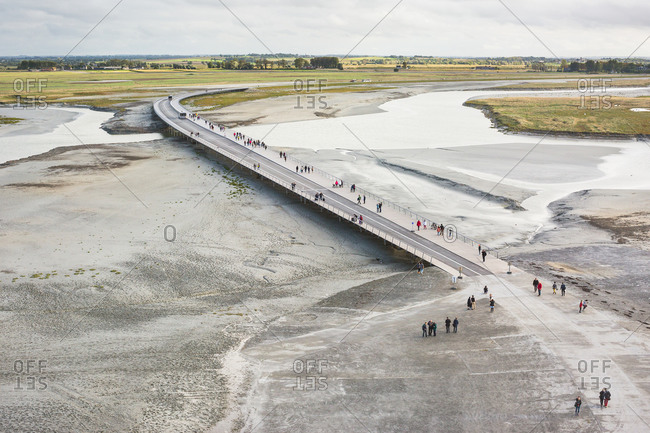 Tourists and buses on causeway, Mont Saint-Michel, France