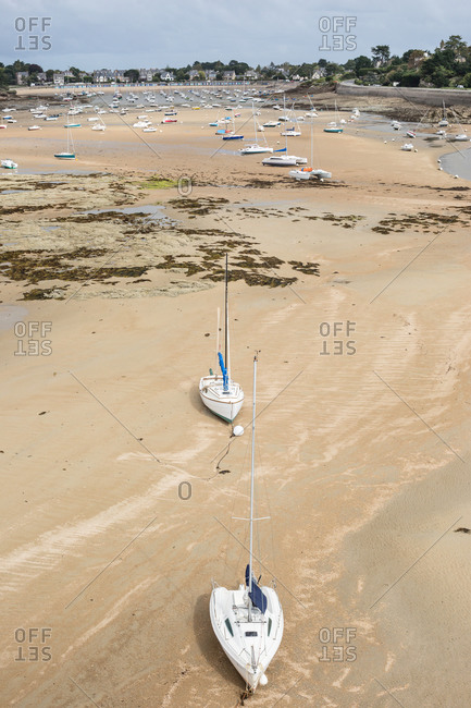 Boats grounded during low tide on Le Fremur River, Saint-Briac-sur-Mer, France
