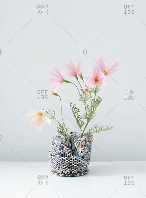 Side view of flower arrangement in paper vase