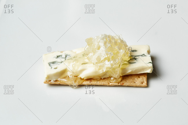 Crackers topped with blue cheese and honey