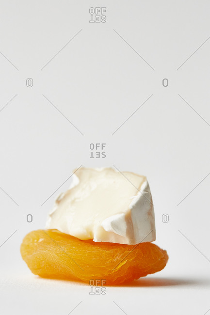 Dried apricot topped with brie