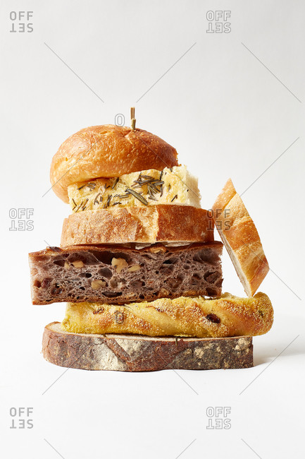 Slices of various types of bread stacked in a pile