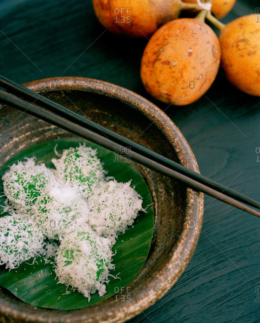 Sweet coconut covered rice balls in bowl, Bali