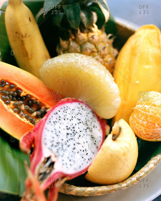 Close-up of different tropical fruits in basket