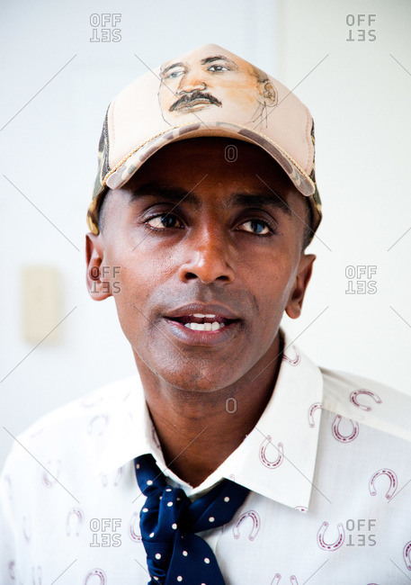 New York City - August 21, 2012: Portrait of Chef Marcus Samuelsson wearing a hat with Dr. King on it