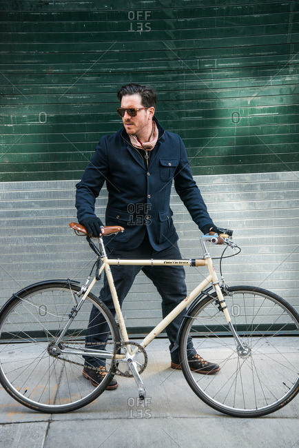 New York City - August 19, 2012: Chef Seamus Mullen on sidewalk with bicycle