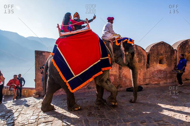 Jaipur, Rajasthan, India -January 7, 2016: Tourists taking selfie while riding an elephant at Amer Fort of Jaipur, Rajasthan