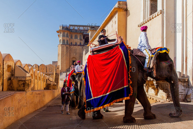 Jaipur, Rajasthan, India -January 7, 2016: Tourists riding elephants at Amer Fort of Jaipur, Rajasthan