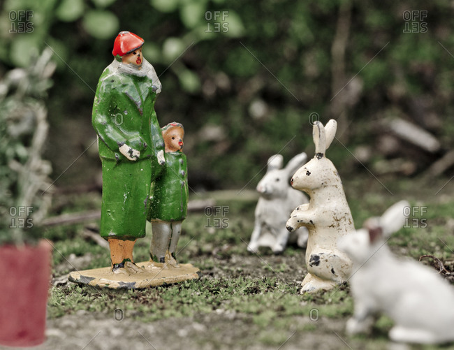 Lead figures of mother and child looking at bunnies at the zoo