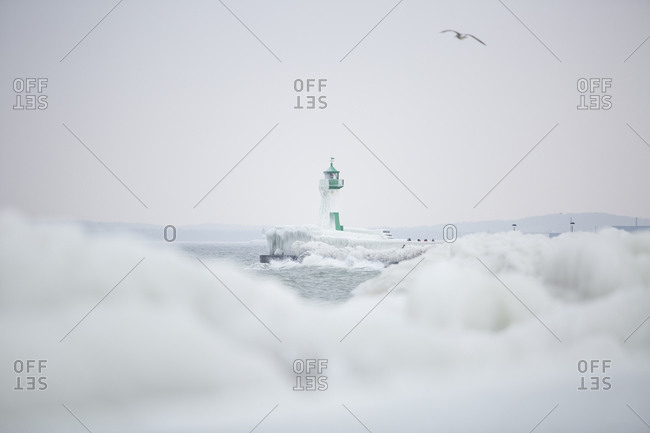 Harbor with lighthouse in winter