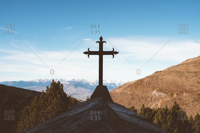 Cross on small mountain chapel