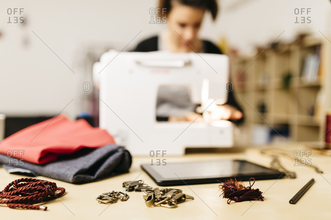 Zippers, fasteners and tassels in a young designer's worktable