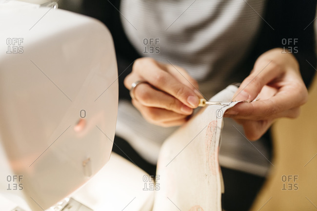 Young designer pulling out seams