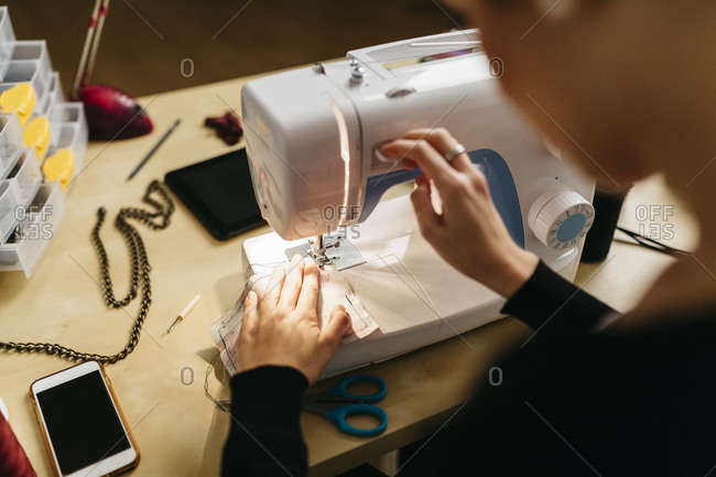 Young fashion designer at her sewing machine