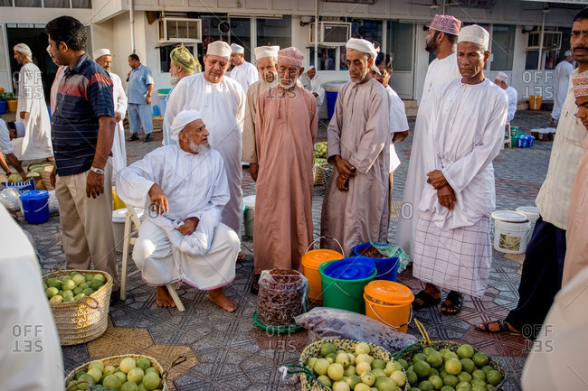 Mutrah, Muscat, Oman - January 1, 2011: Men at food market in Oman