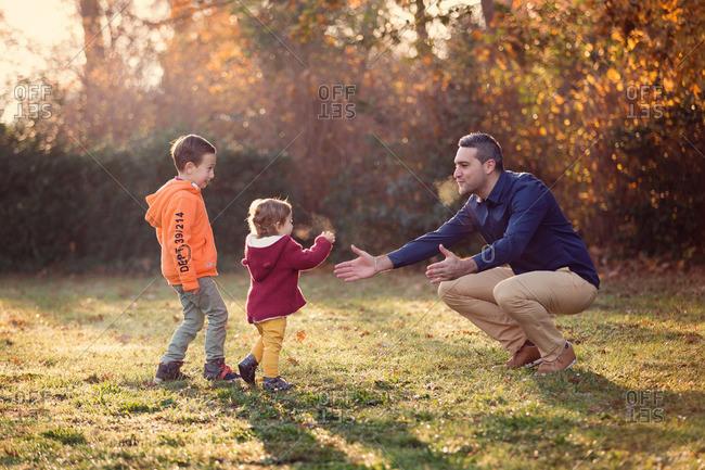 Toddler girl running to man's arms