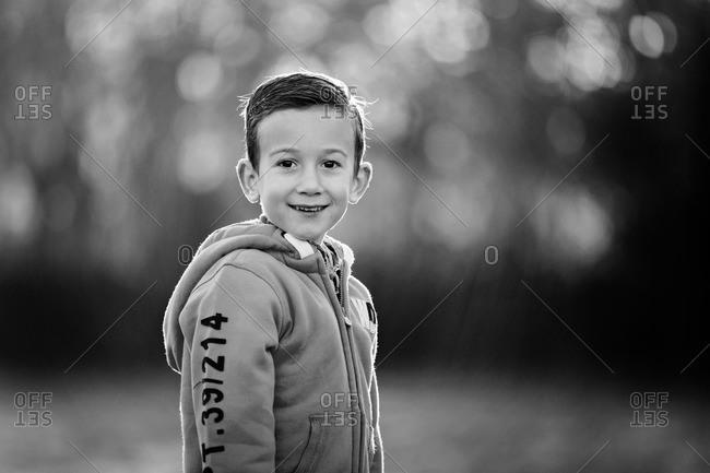 Smiling boy's portrait, rural setting