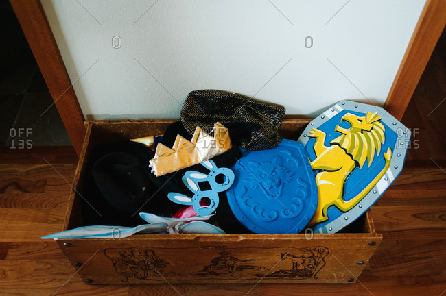 Childrens' costumes in a wooden box