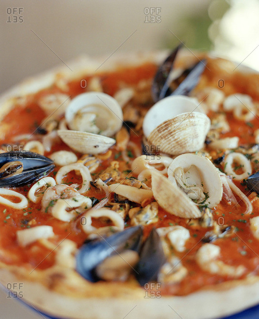Clam shells on a pizza