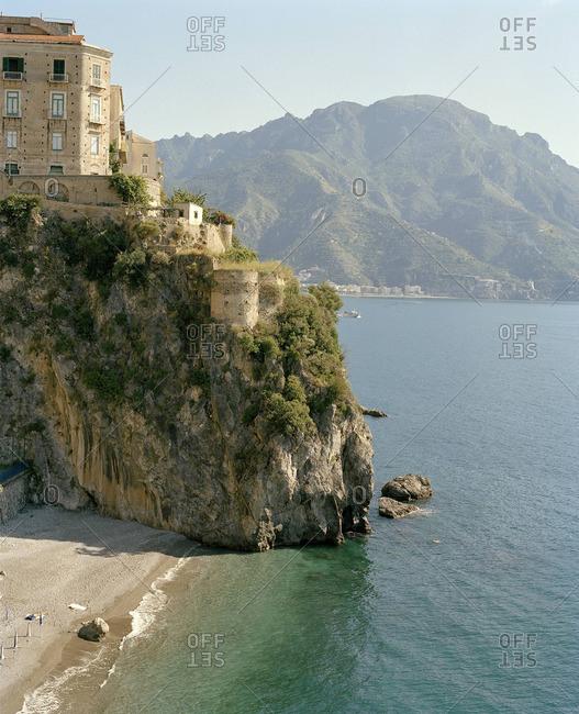 Building on sheer coastal cliff