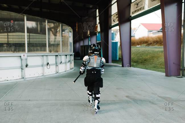 Child walking in hockey uniform