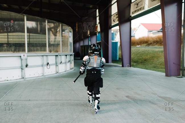Child walking in hockey uniform