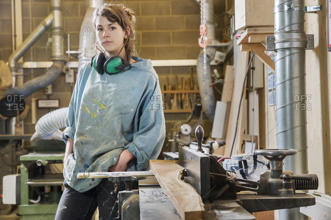 Young woman in a woodworking shop