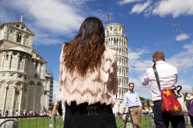 Pisa, Italy - May 27, 2015: Tourists taking photos at Piazza dei Miracoli, Pisa, Italy
