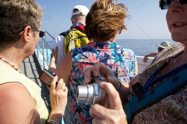 Monterosso, Italy   - June 2, 2015: A group of tourists aboard boat excursion
