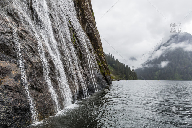 Water cascading down cliffs in Misty Fjord National Park, Alaska, United States of America