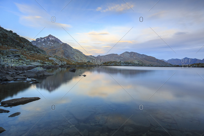 Peak Tambo reflected in Lake Bergsee at dawn, Chiavenna Valley, Spluga Valley, Switzerland