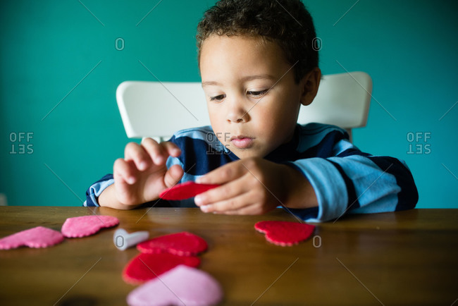 Little boy making a Valentine\'s Day craft