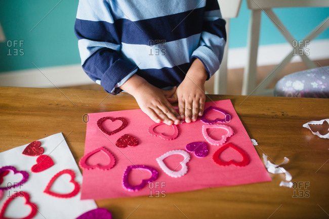 Close up of little boy making a Valentine\'s Day craft