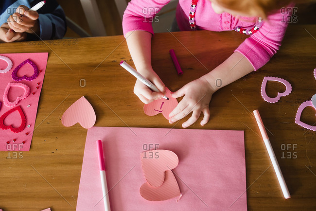 Children making a Valentine\'s Day craft