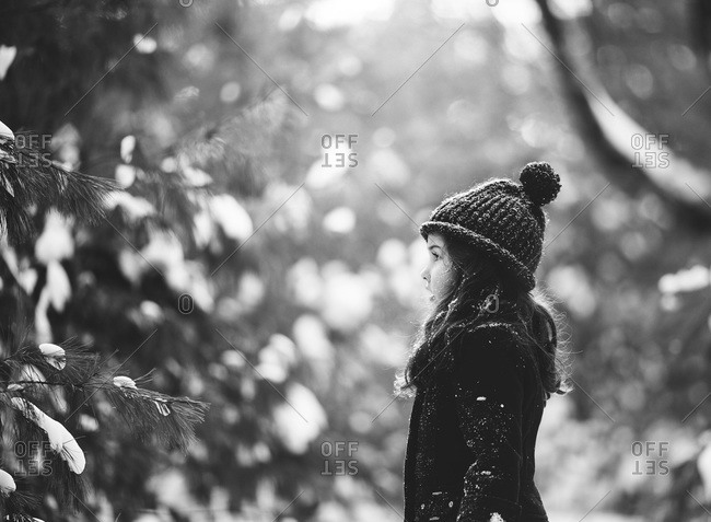 Little girl playing outside in winter in black and white