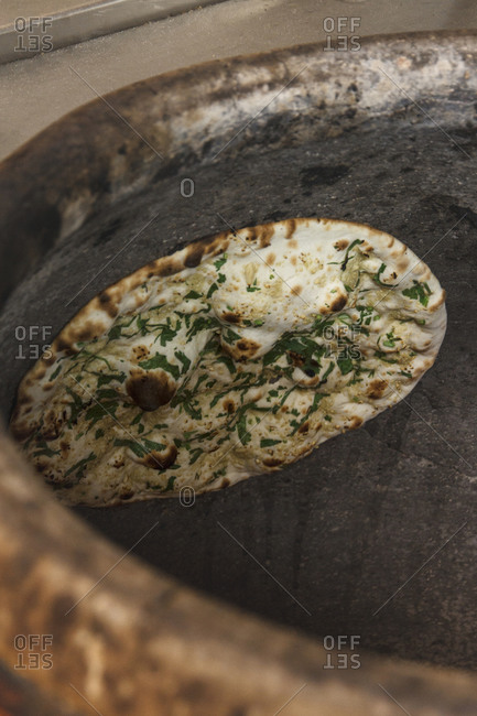 Indian Naan with garlic and persil cooked in a traditional oven
