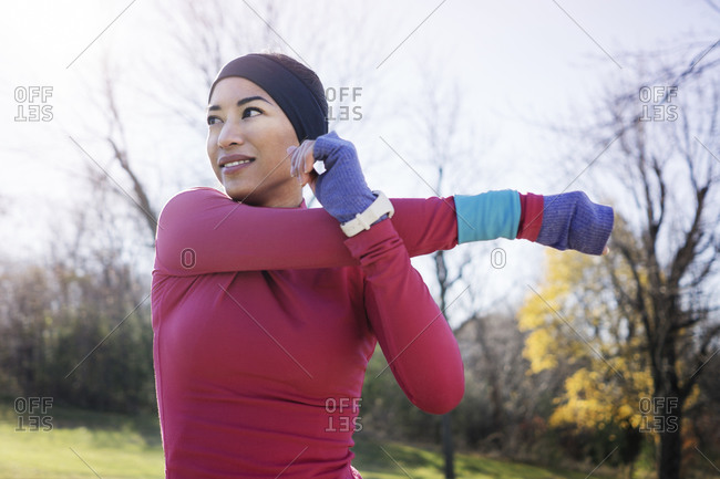Woman stretching arms before outdoor workout
