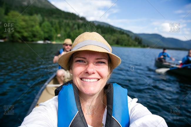 Woman taking a selfie in a canoe