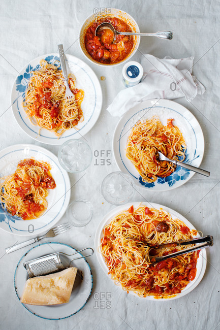 Blue floral plates filled with spaghetti and tomato sauce