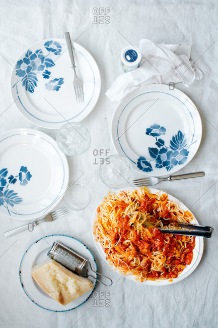 Spaghetti with tomato sauce on blue floral plates
