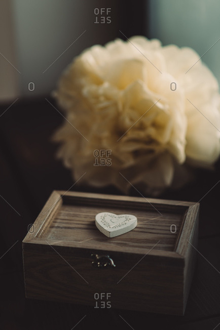 Wooden keepsake box in front of white flowers