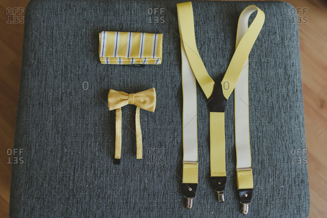 Yellow groom accessories laid out