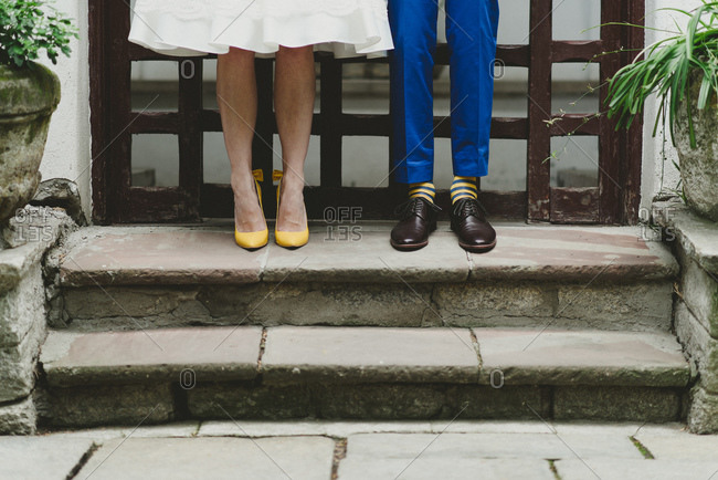 Yellow shoes and socks on a bride and groom