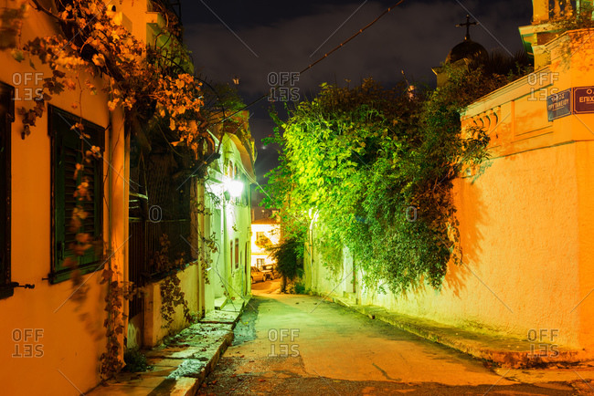 Narrow street at night in Athens, Greece