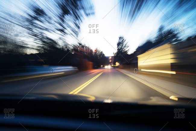 Blurred motion of driving on street at dusk