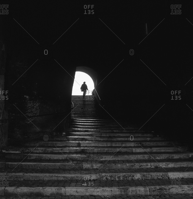 Person silhouetted at top of stairway
