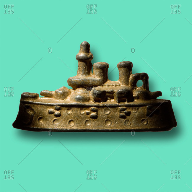 Toy warship on blue background