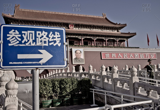 Sign pointing outside building in China