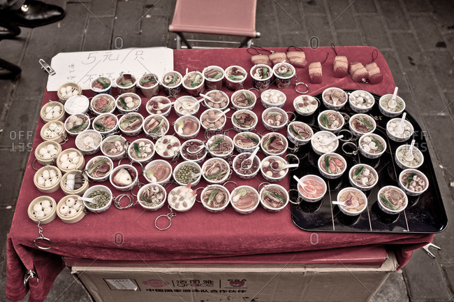 Soup bowls on table outside, China