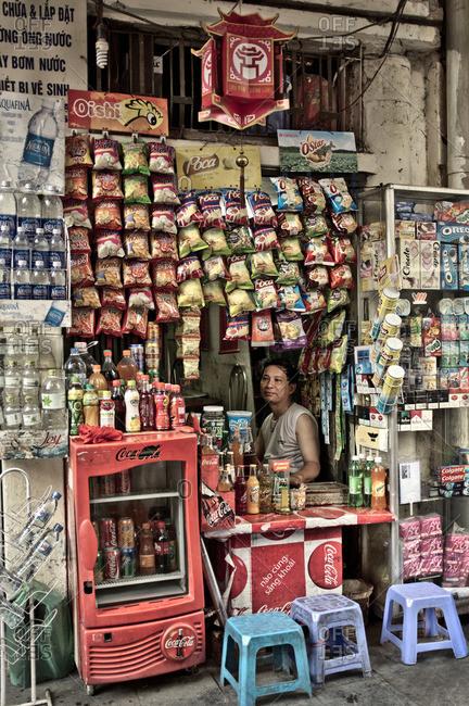 Hanoi, Vietnam - September 26, 2011: Man in convenience stand, Vietnam